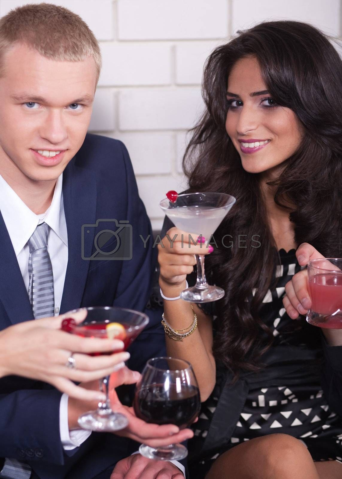 Couple on date in bar or night club enjoying wine, romantic eventing..