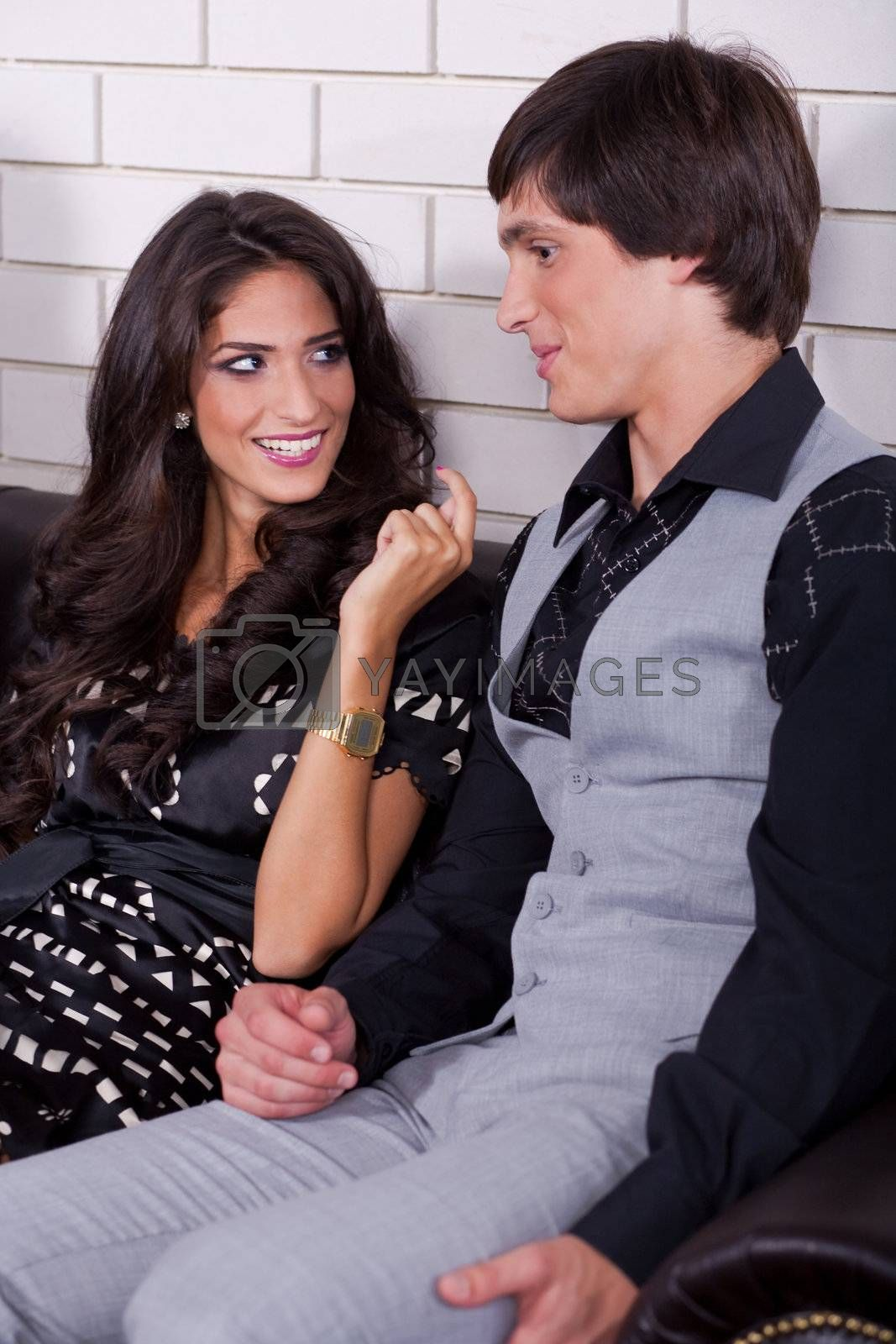 Attractive young couple on date in bar or night club..
