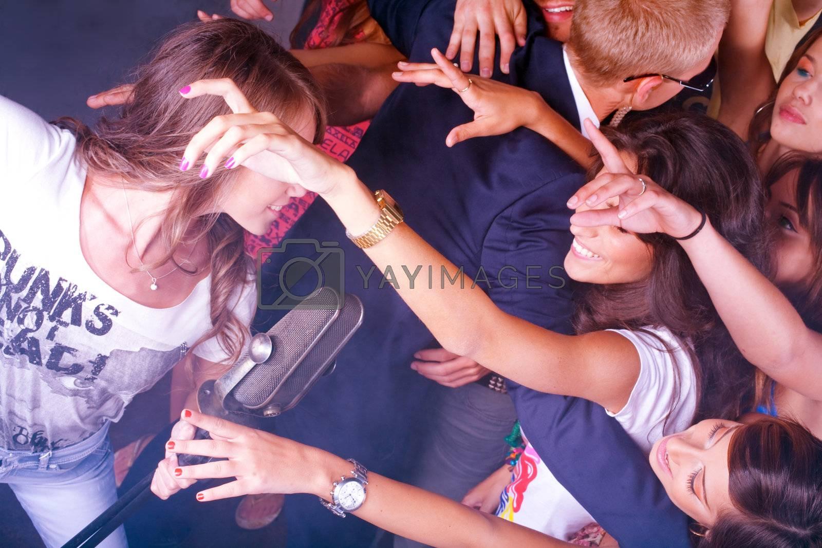 Karaoke girl performing in night club by get4net