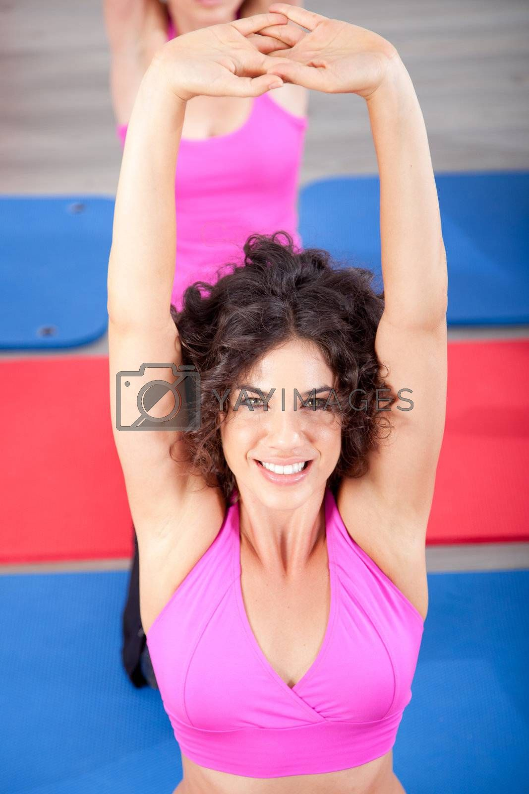 Attractive young woman working out. Aerobics class..