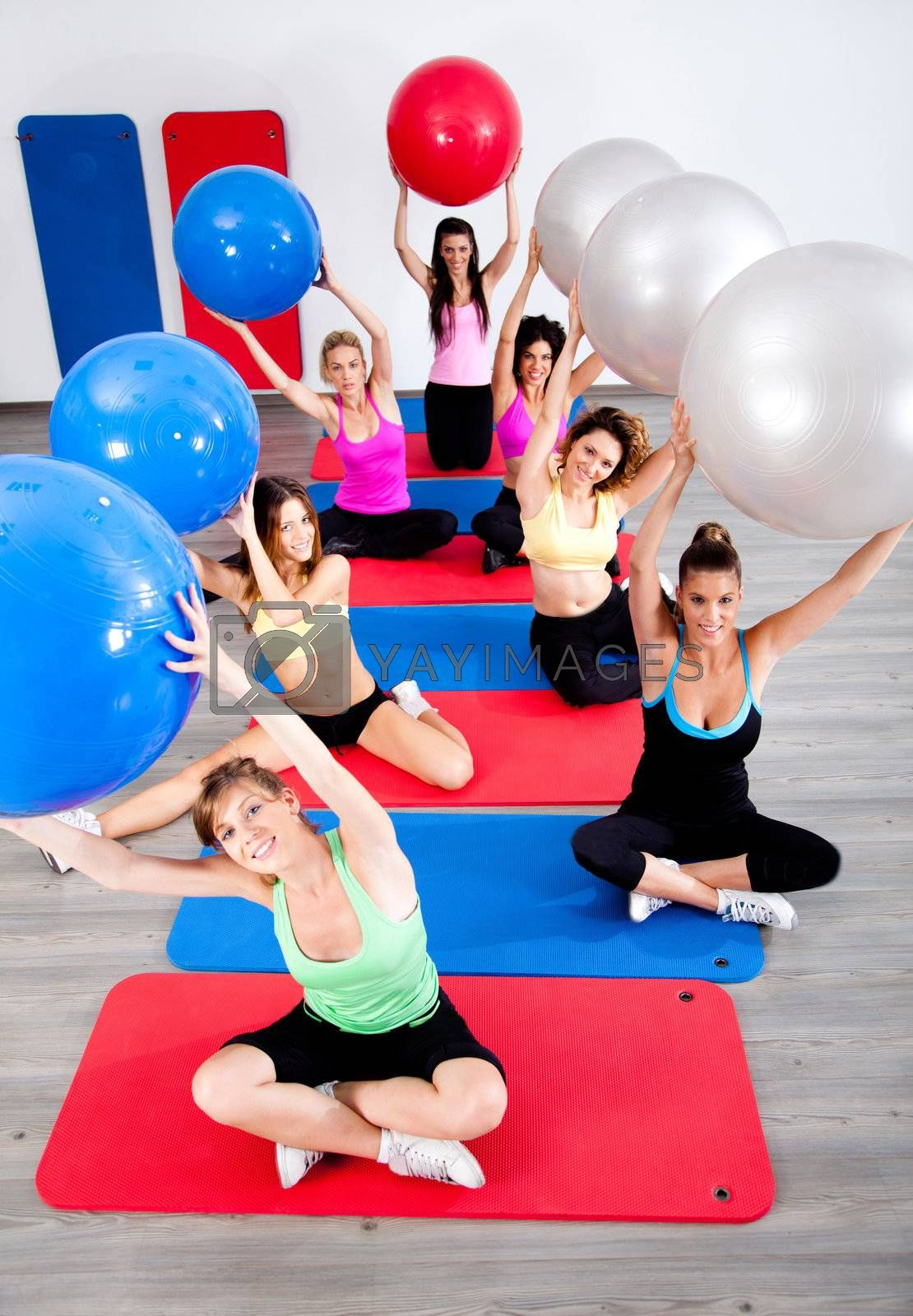 Young people in the fitness club exercising.