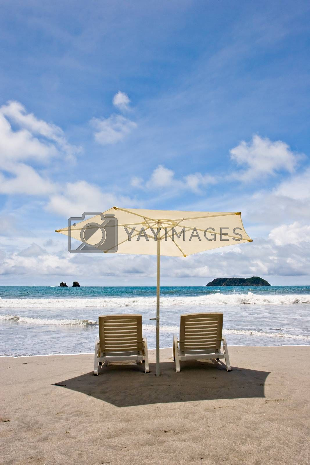 Two chairs and umbrella at the beach. Manuel Antonio, Costa Rica.