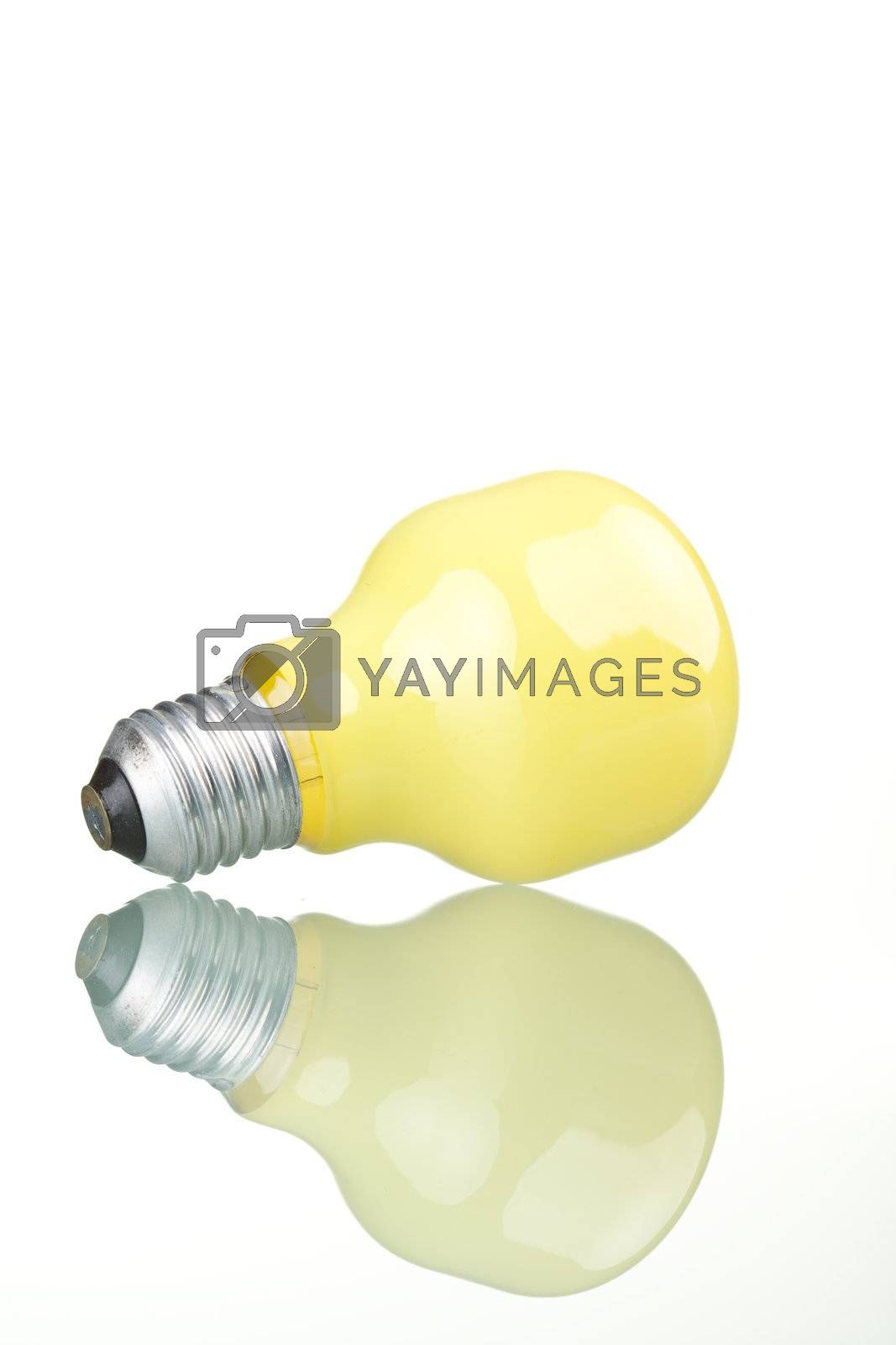 Yellow bulb with reflection, isolated on white background.