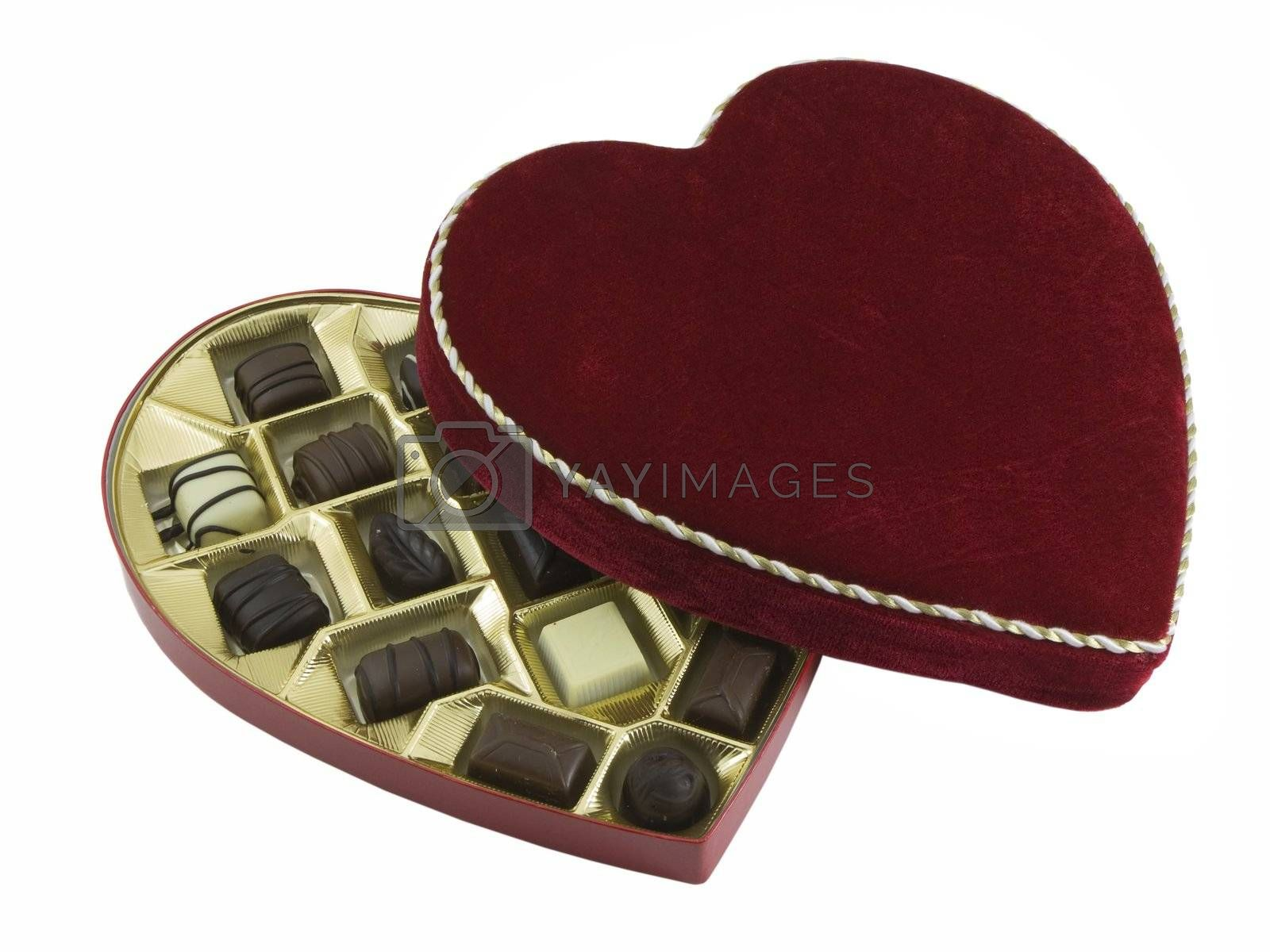 Opened box of valentines chocolates isolated on white