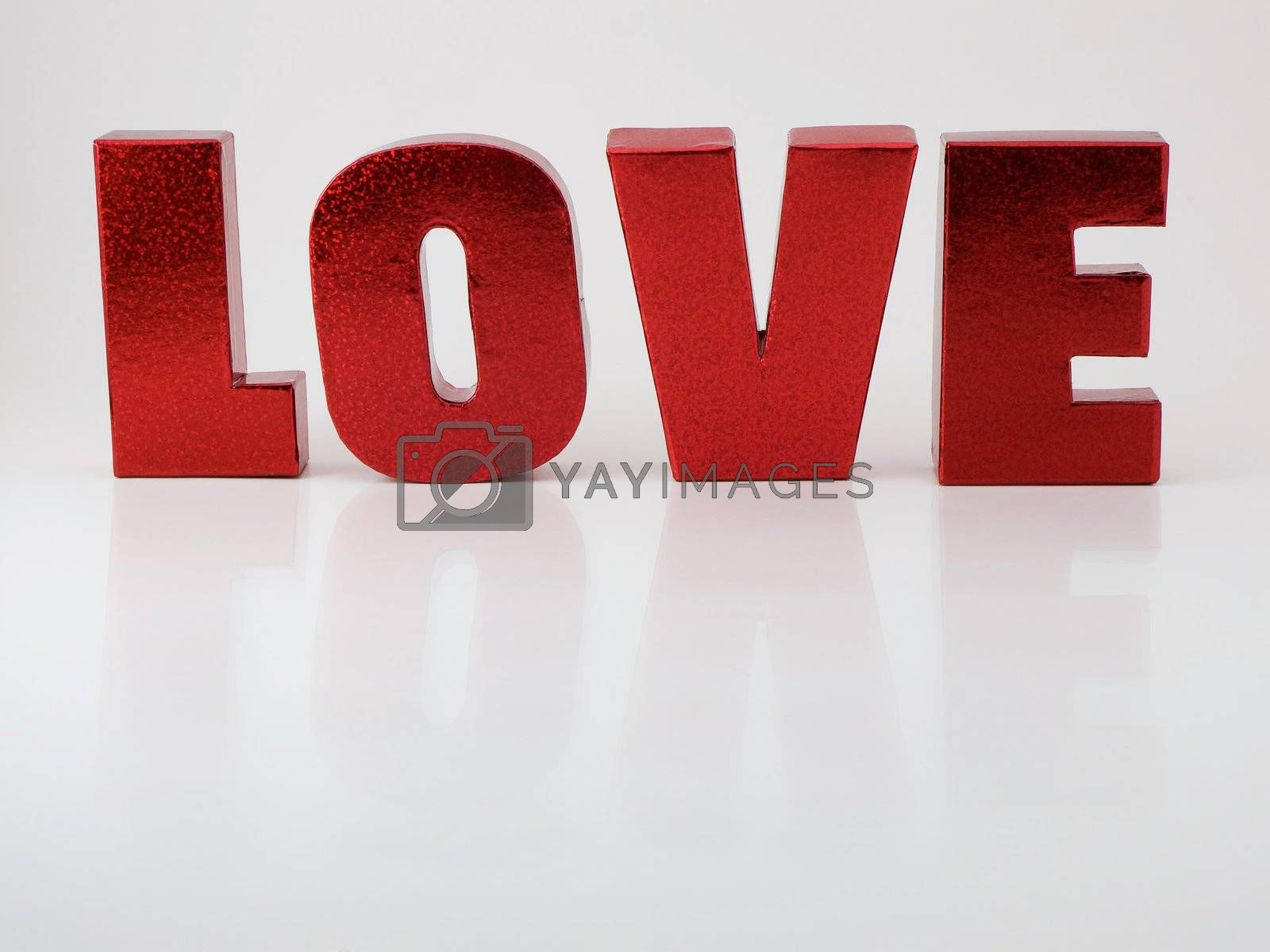 Red letters that spell love with reflection