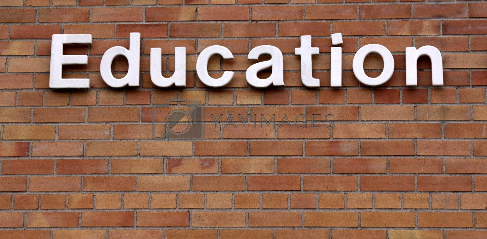 The word education on a brick wall.