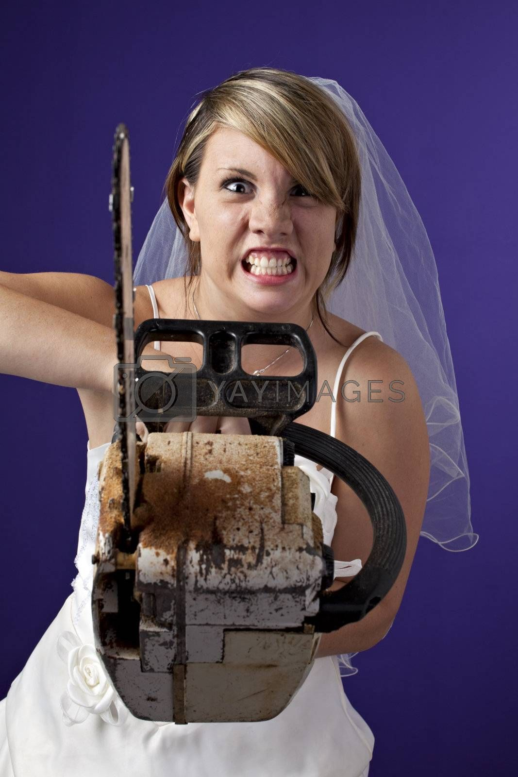 angry young bride with an chainsaw on a dark blue background