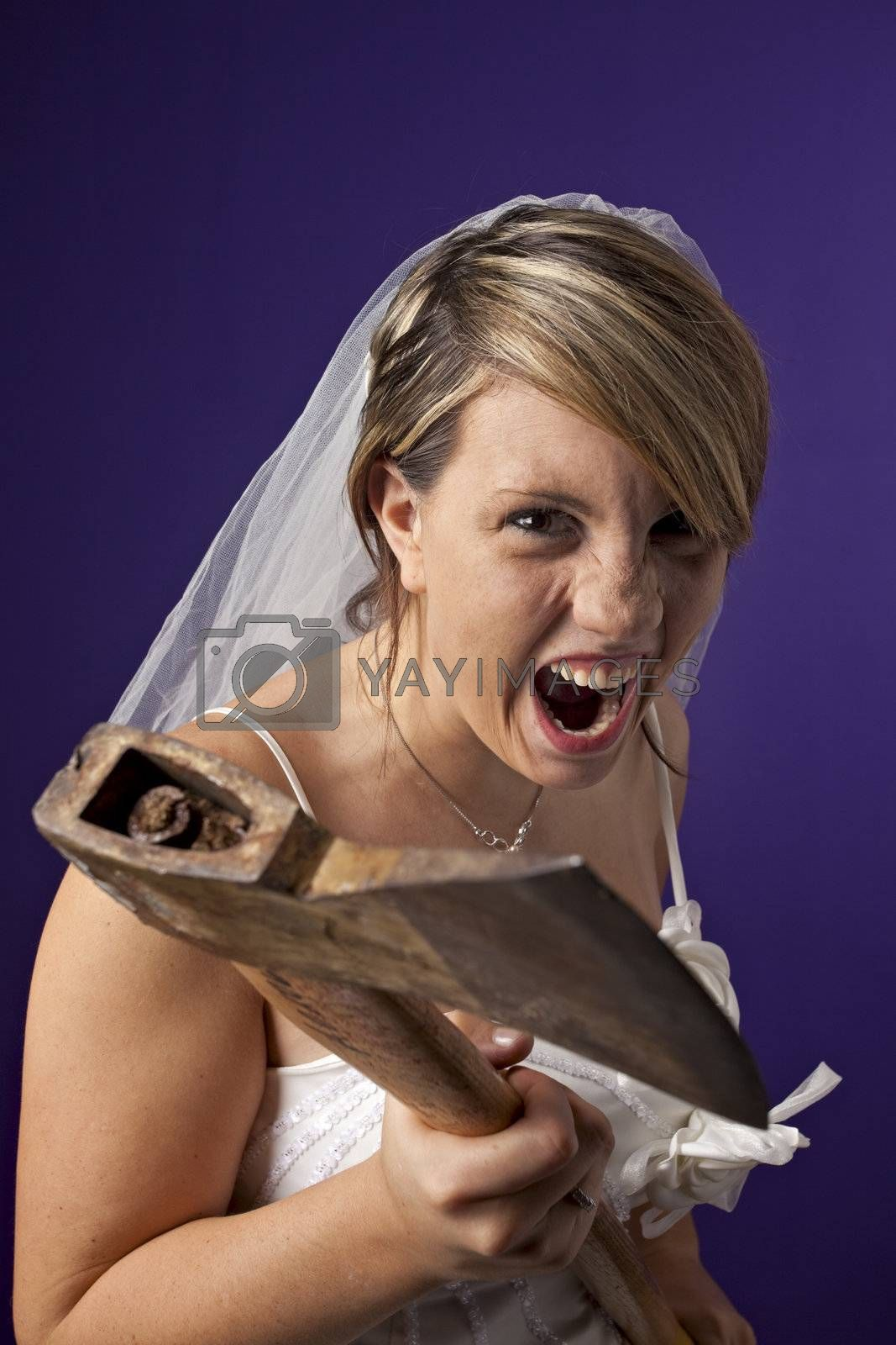 angry young bride with an axe on a dark blue background