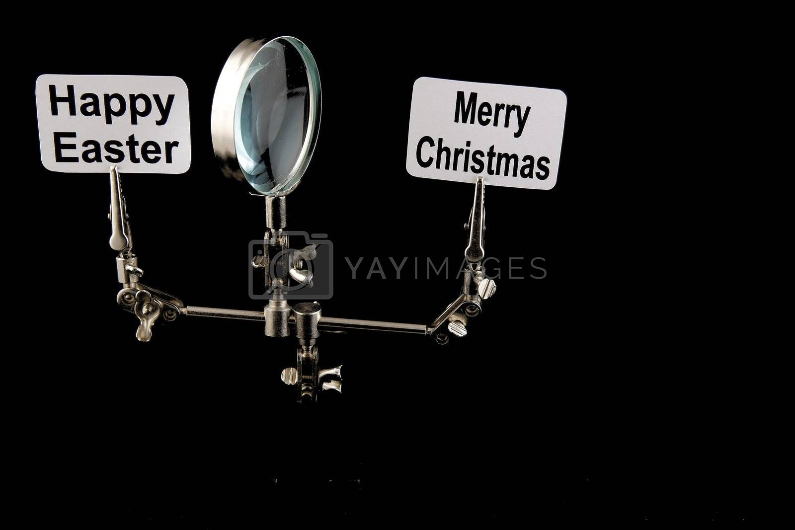 """figure of steel man with """"Happy Easter"""" and """"Merry Chrostmas"""" inscriptions on black background"""