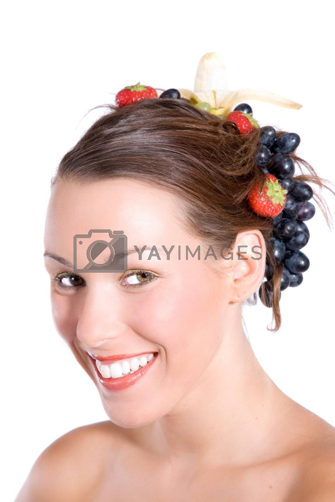 Beautiful brunette with fruit in her hair and radiant smile