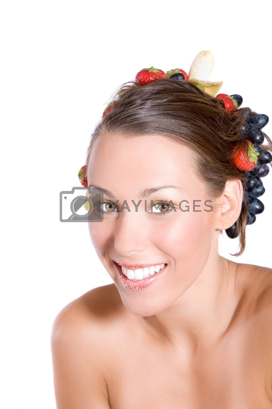 Beautiful girl with radiant smile and fruit in her hair