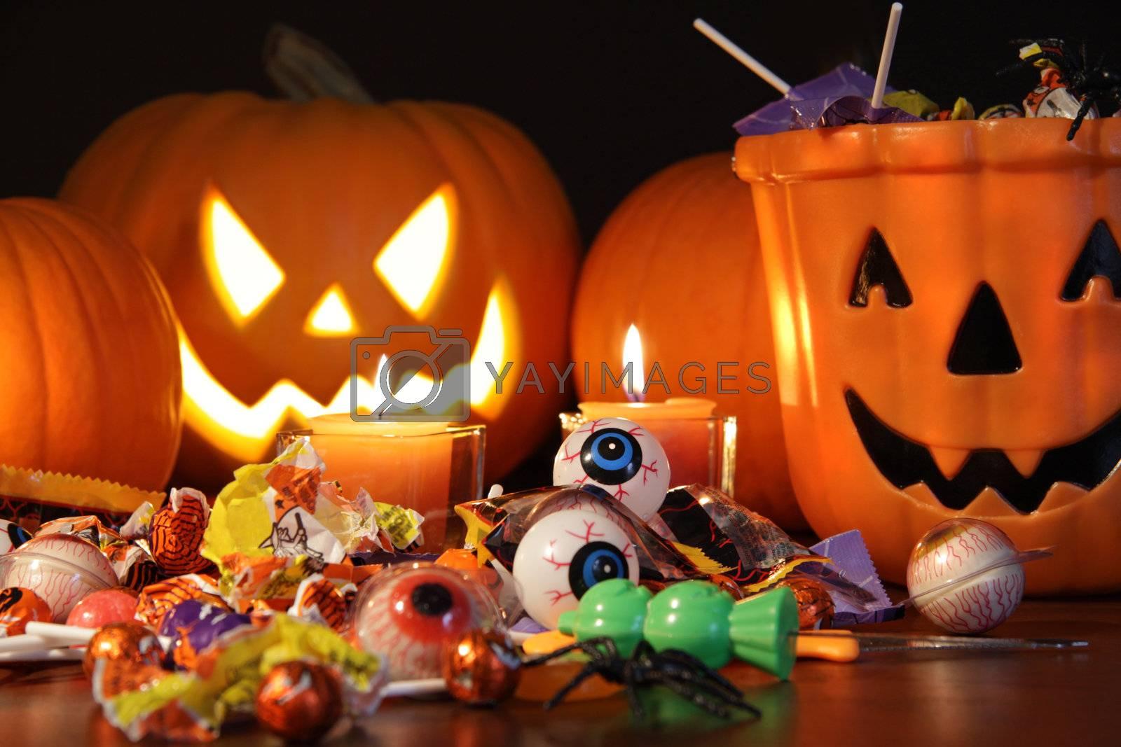 Closeup of candies with pumpkins after Halloween festivities