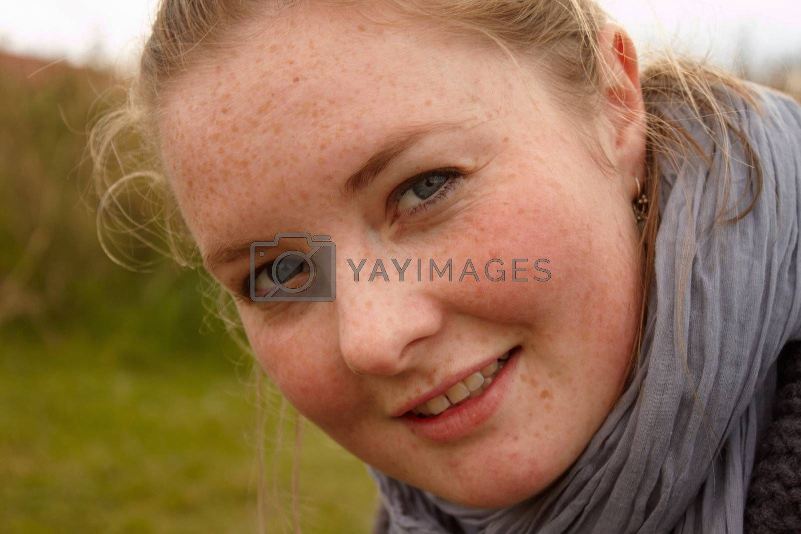 Royalty free image of Portrait of a cute young woman looking  by FreedomImage