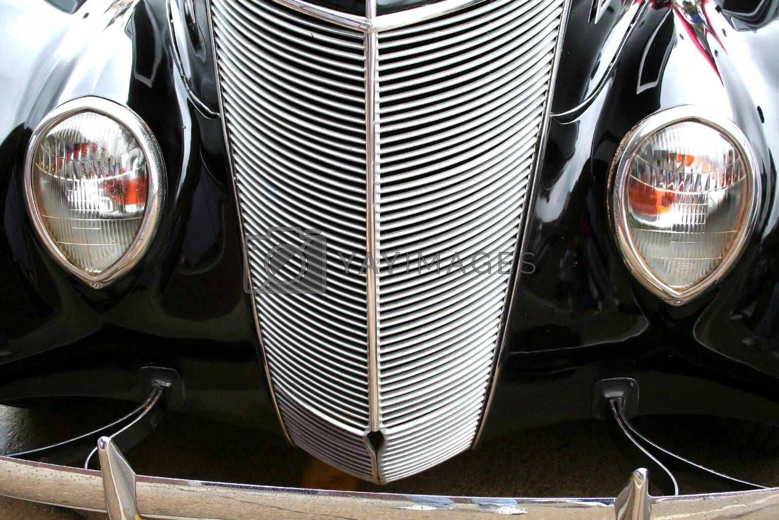 close up shot of black colored luxurious classic car