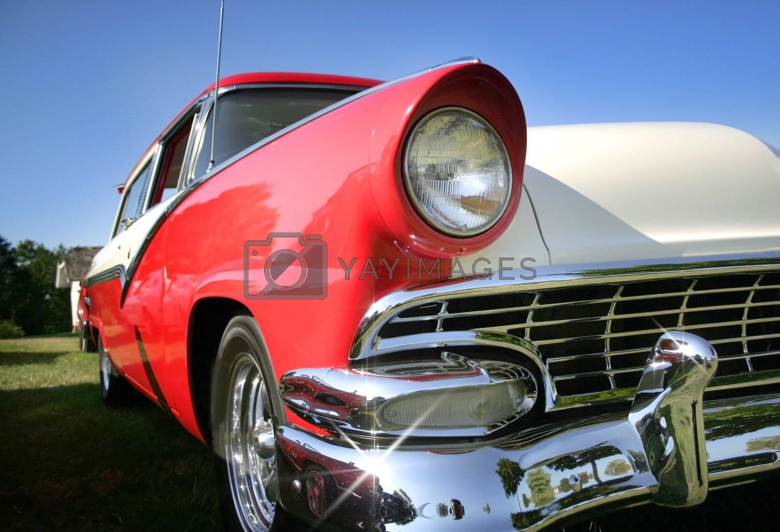 Sparkling Red and tan colored classic car