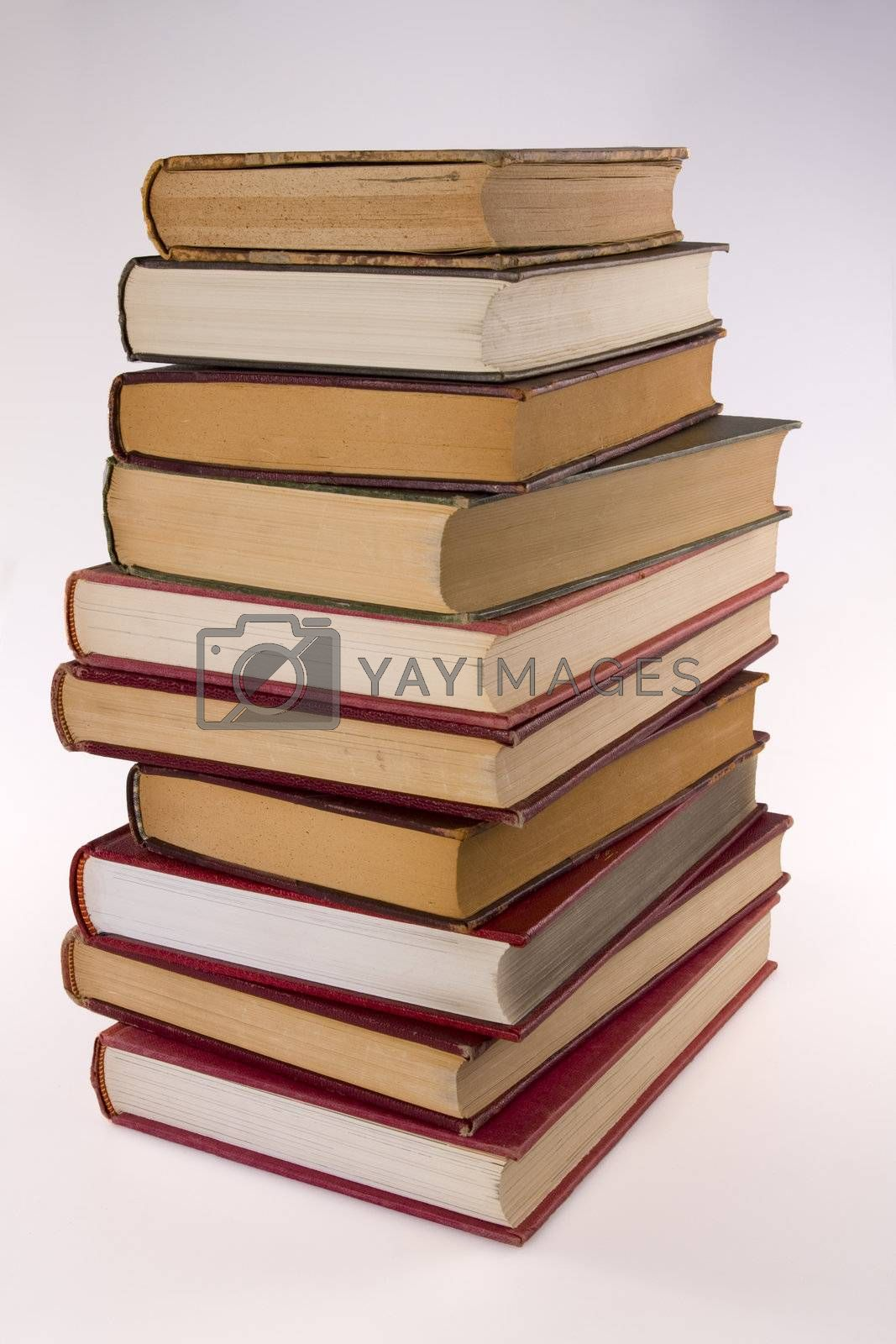 Stack of encyclopedia books over white background