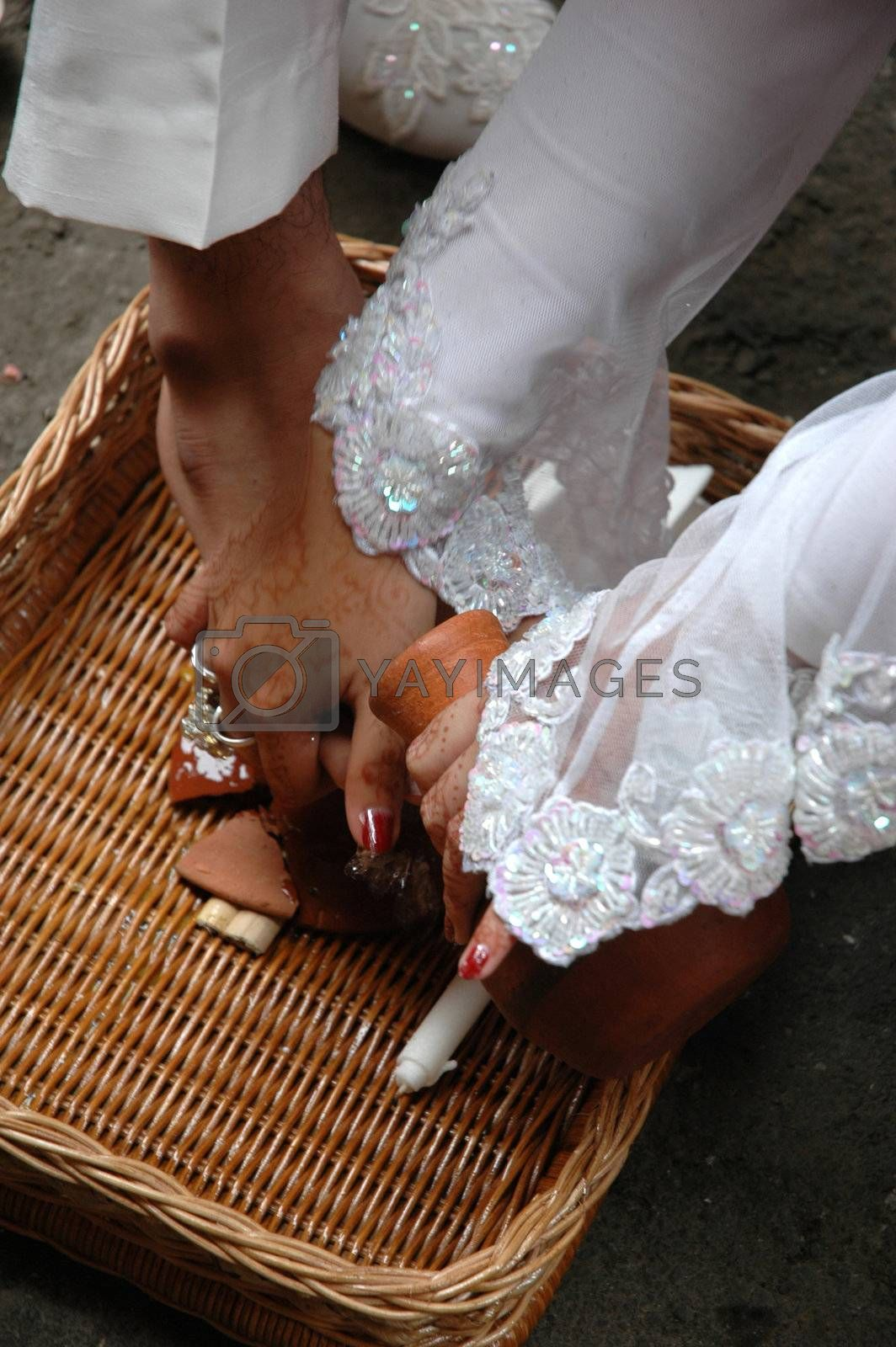 one part of traditional indonesian marriage process called nincak endog