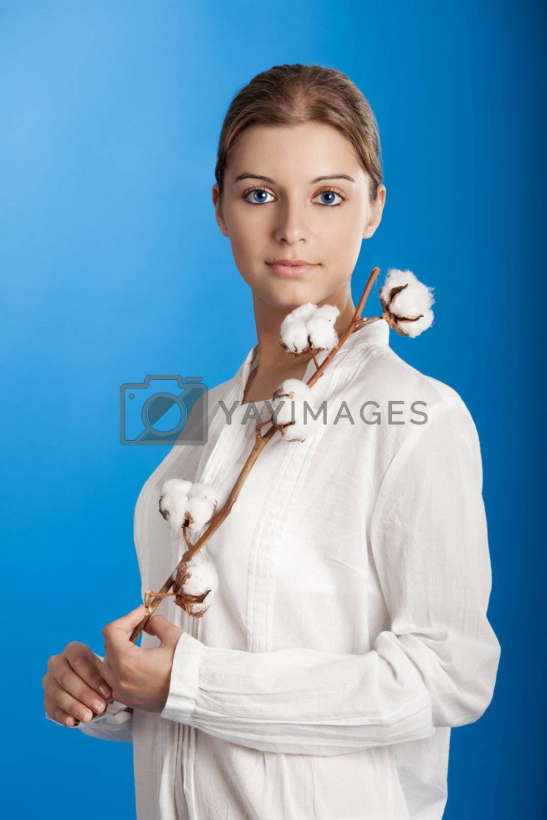 Portrait of a Fresh and Beautiful young woman holding a cotton plant