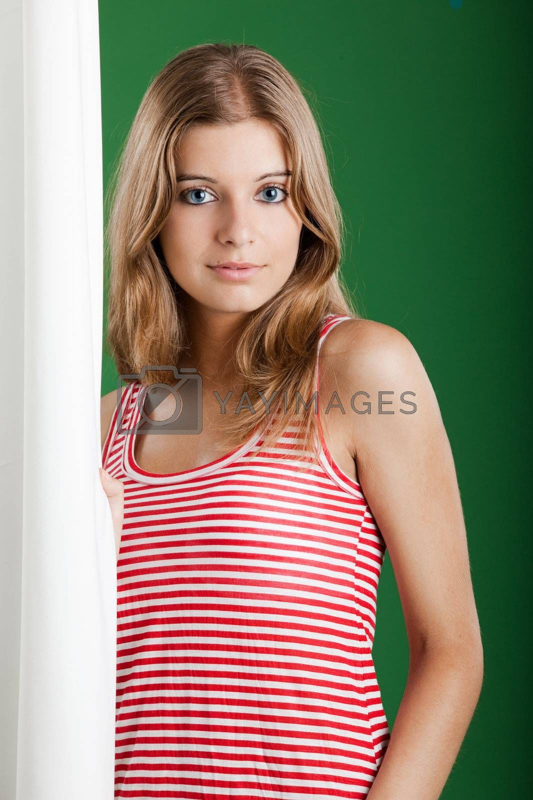 Portrait of fresh and Beautiful young woman over a green background