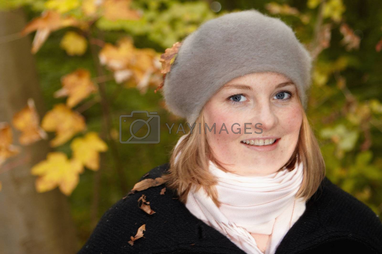 Royalty free image of Fall - Cute pretty woman smiling  by FreedomImage