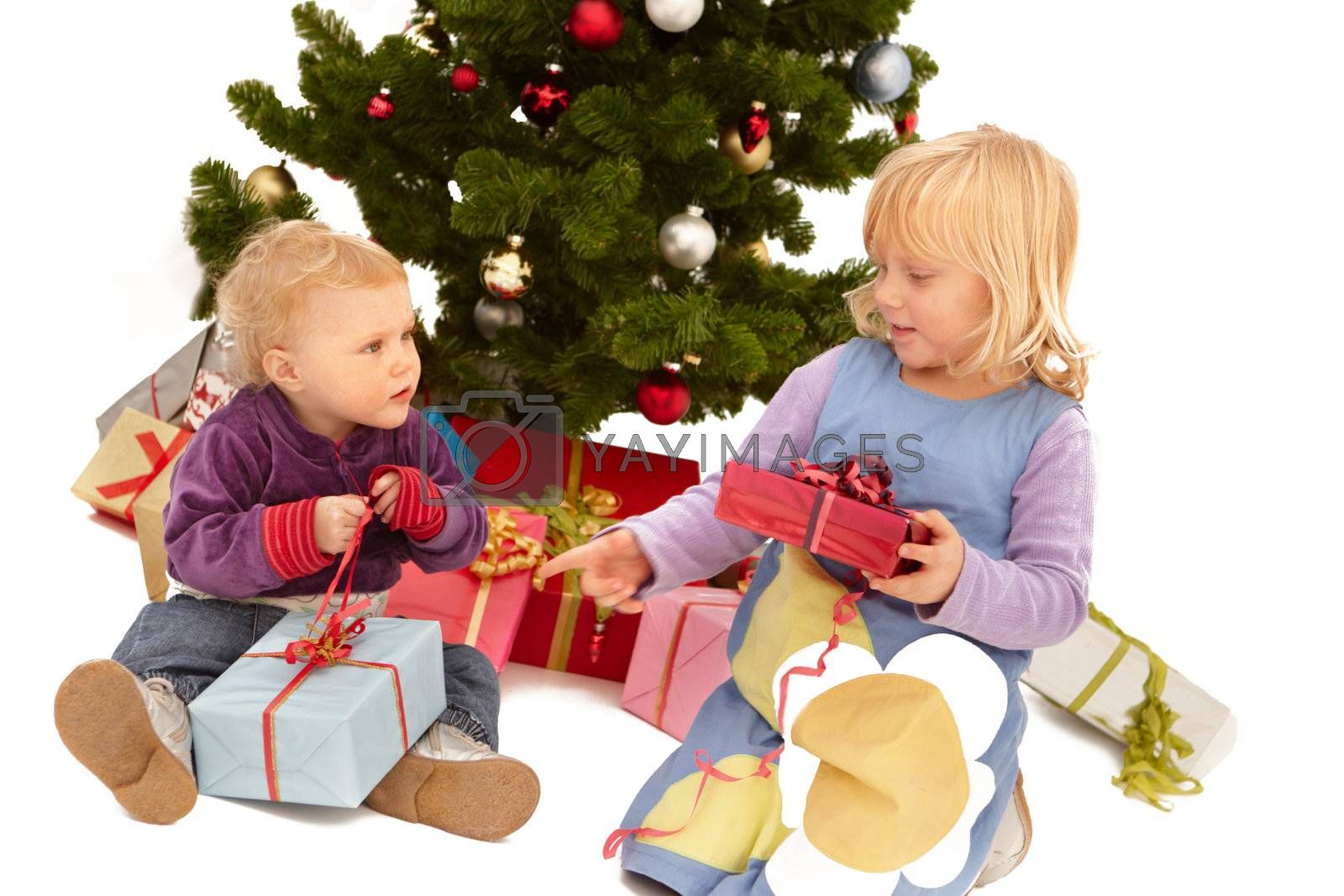 Royalty free image of Christmas - Your present is bigger than mine! by FreedomImage
