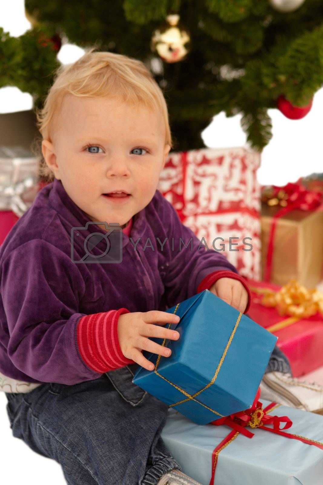 Royalty free image of Christmas - child opening x-mas gifts by FreedomImage