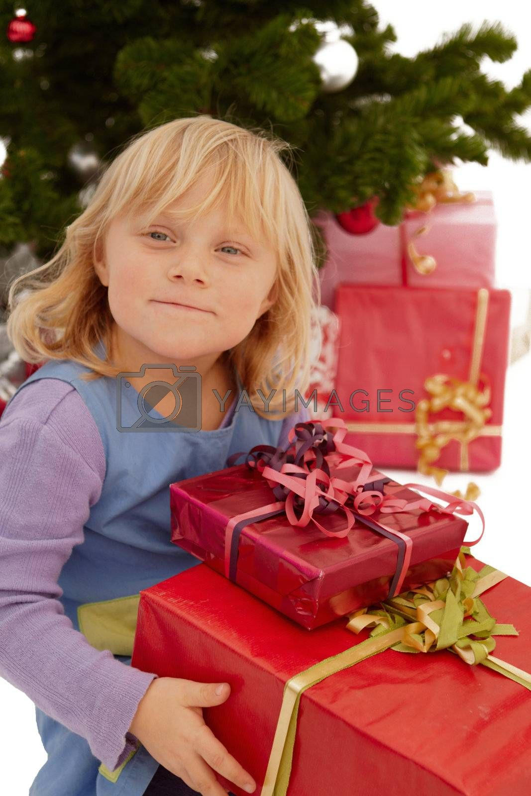 Royalty free image of Christmas - Little girl with lots of presents by FreedomImage