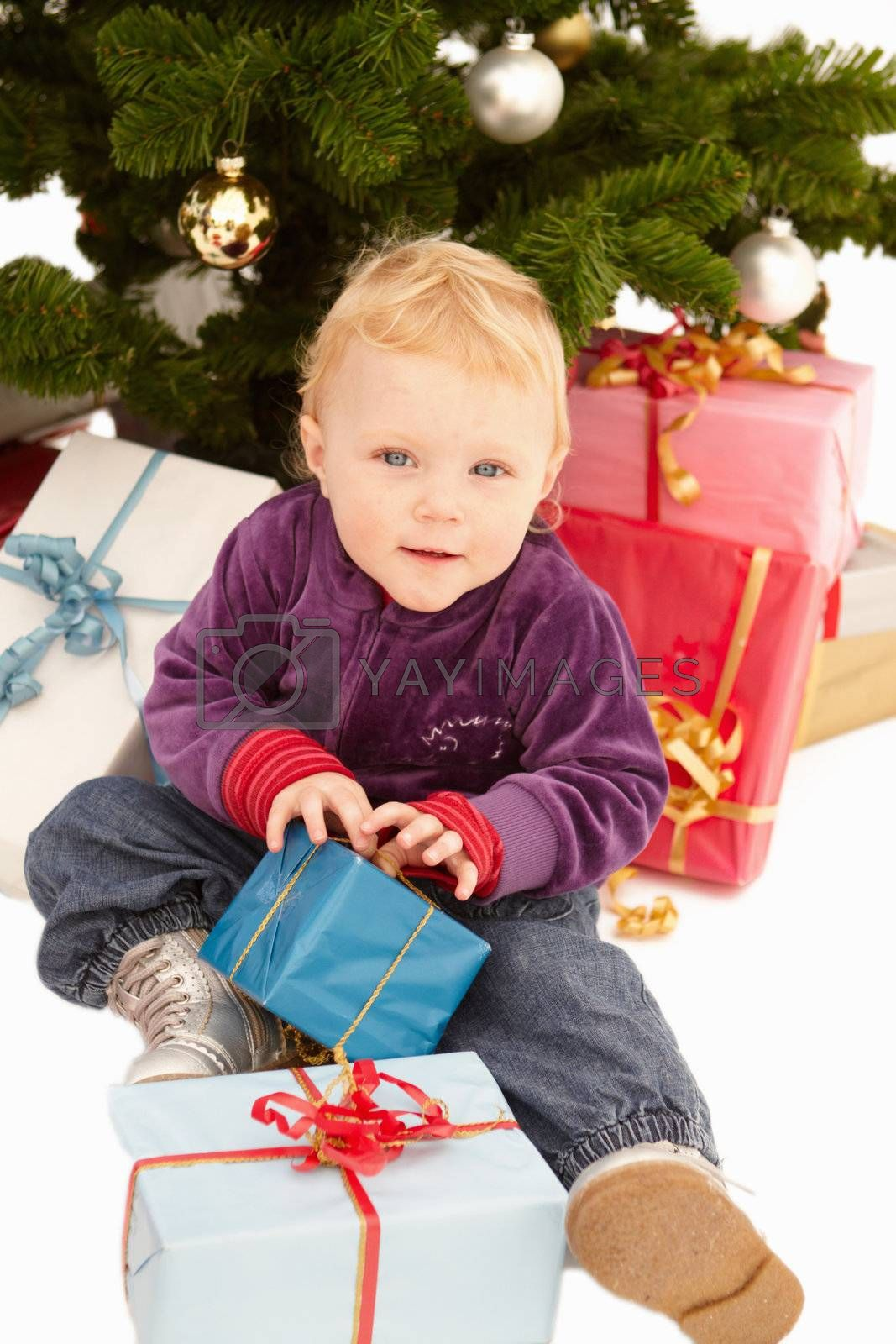 Royalty free image of Christmas - Cute child opening gifts  by FreedomImage