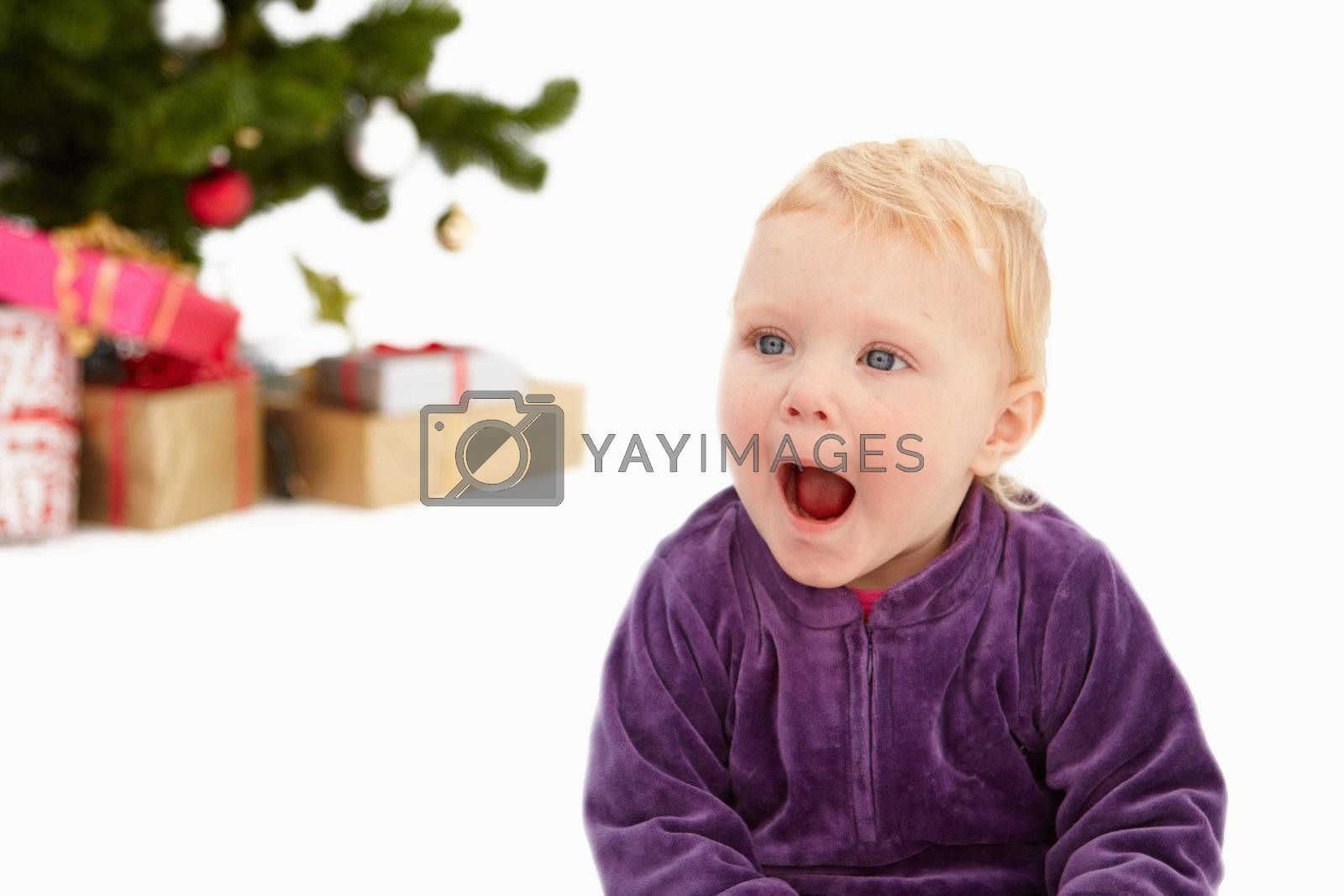 Royalty free image of Surprise - Cute child at christmas time by FreedomImage