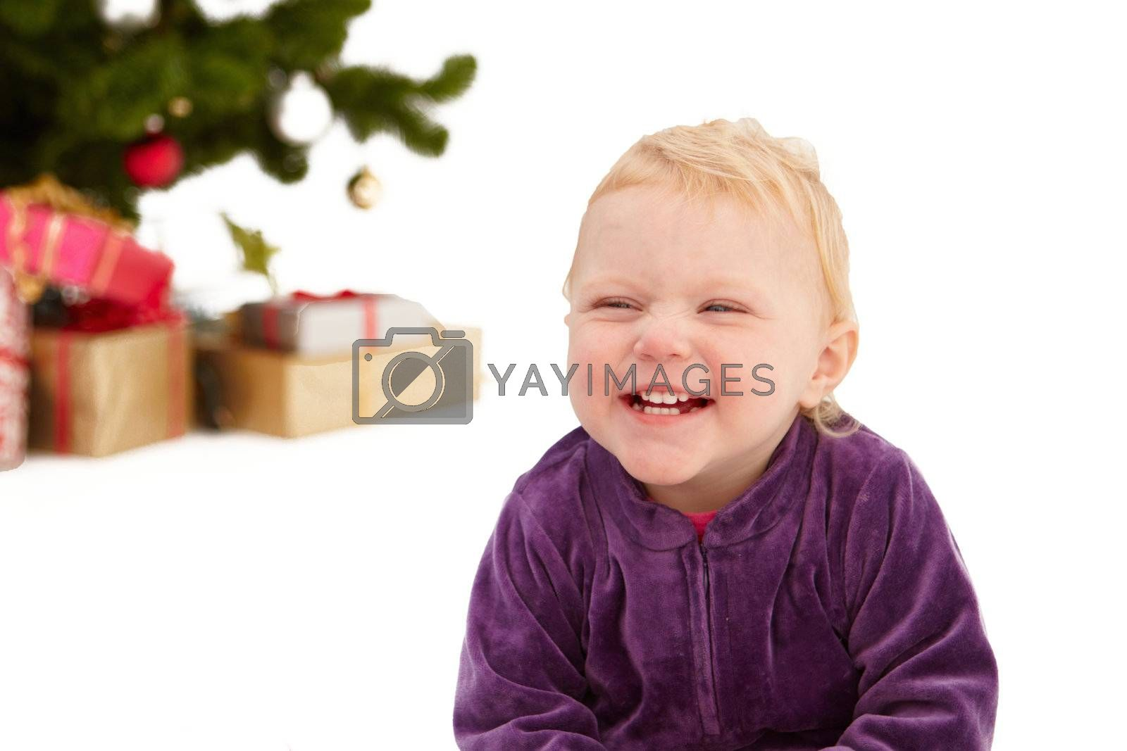 Royalty free image of Christmas - Cute little girl smiling on white  by FreedomImage