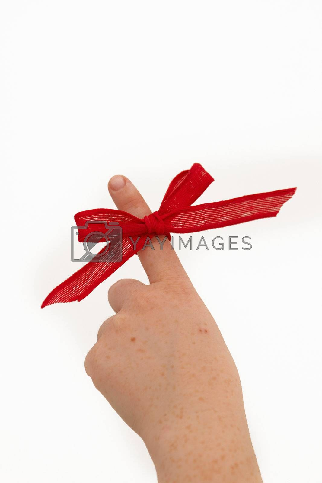 Royalty free image of Pointing a ribbon on a finger by FreedomImage