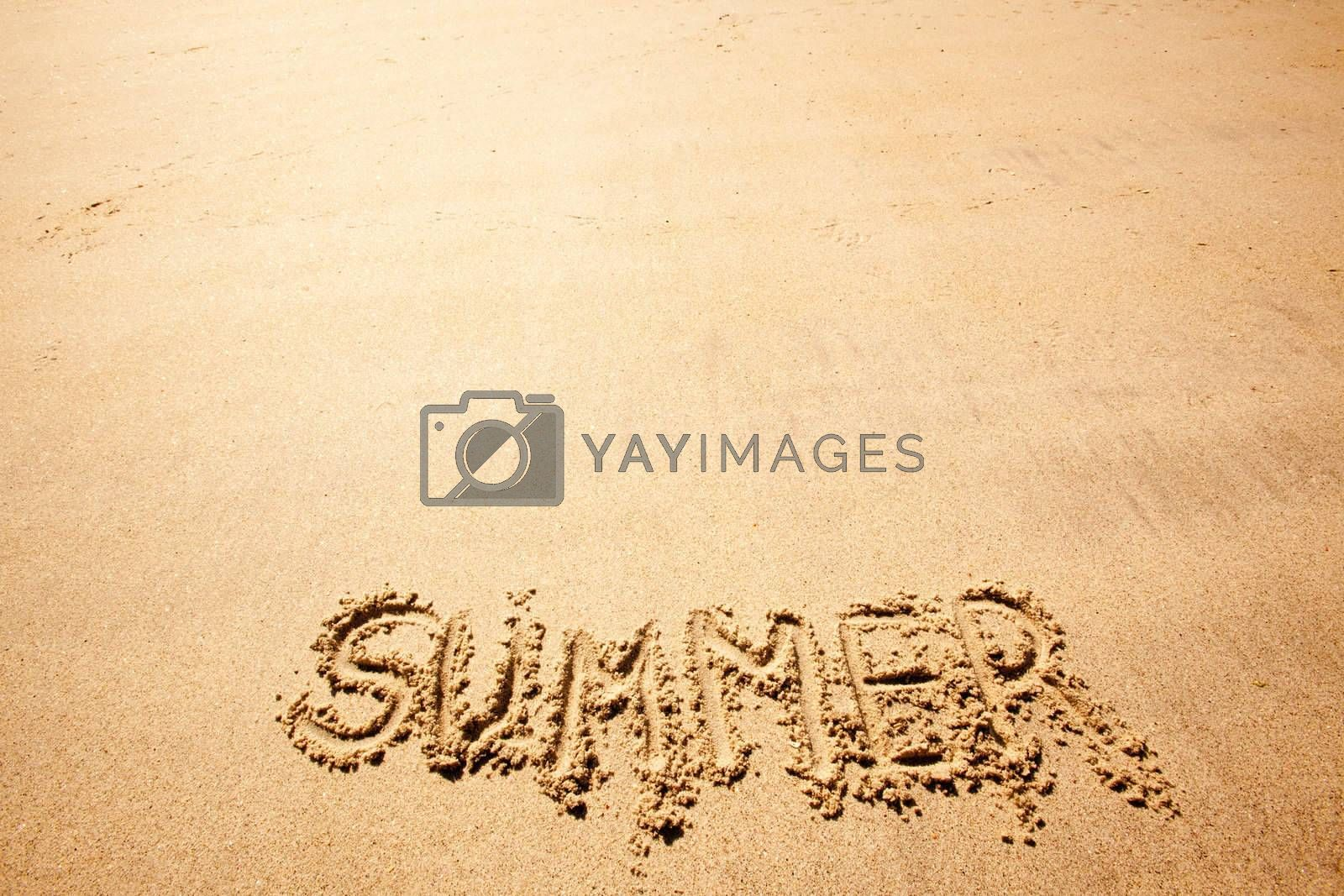 The word summer written in the sand at a beach