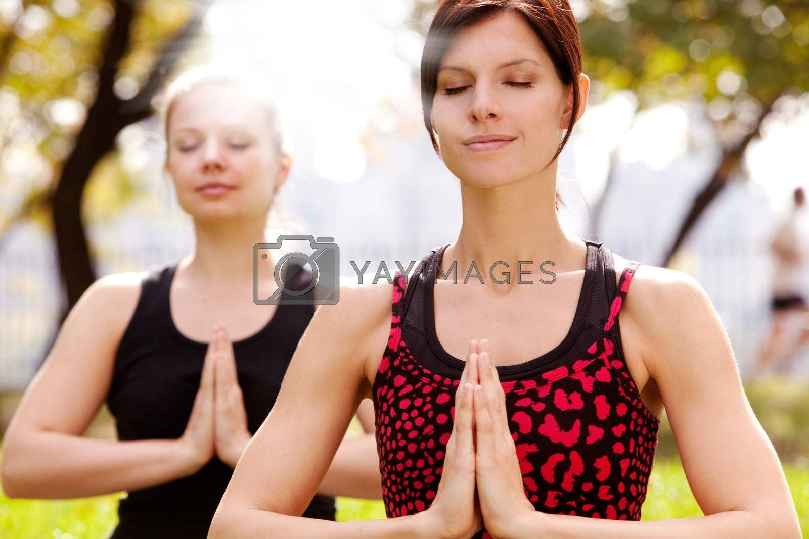 Meditation in the a park on a warm summer day