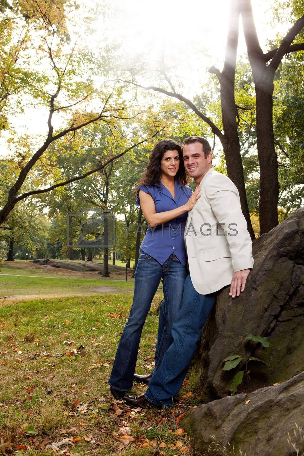 A happy couple relaxing in the park