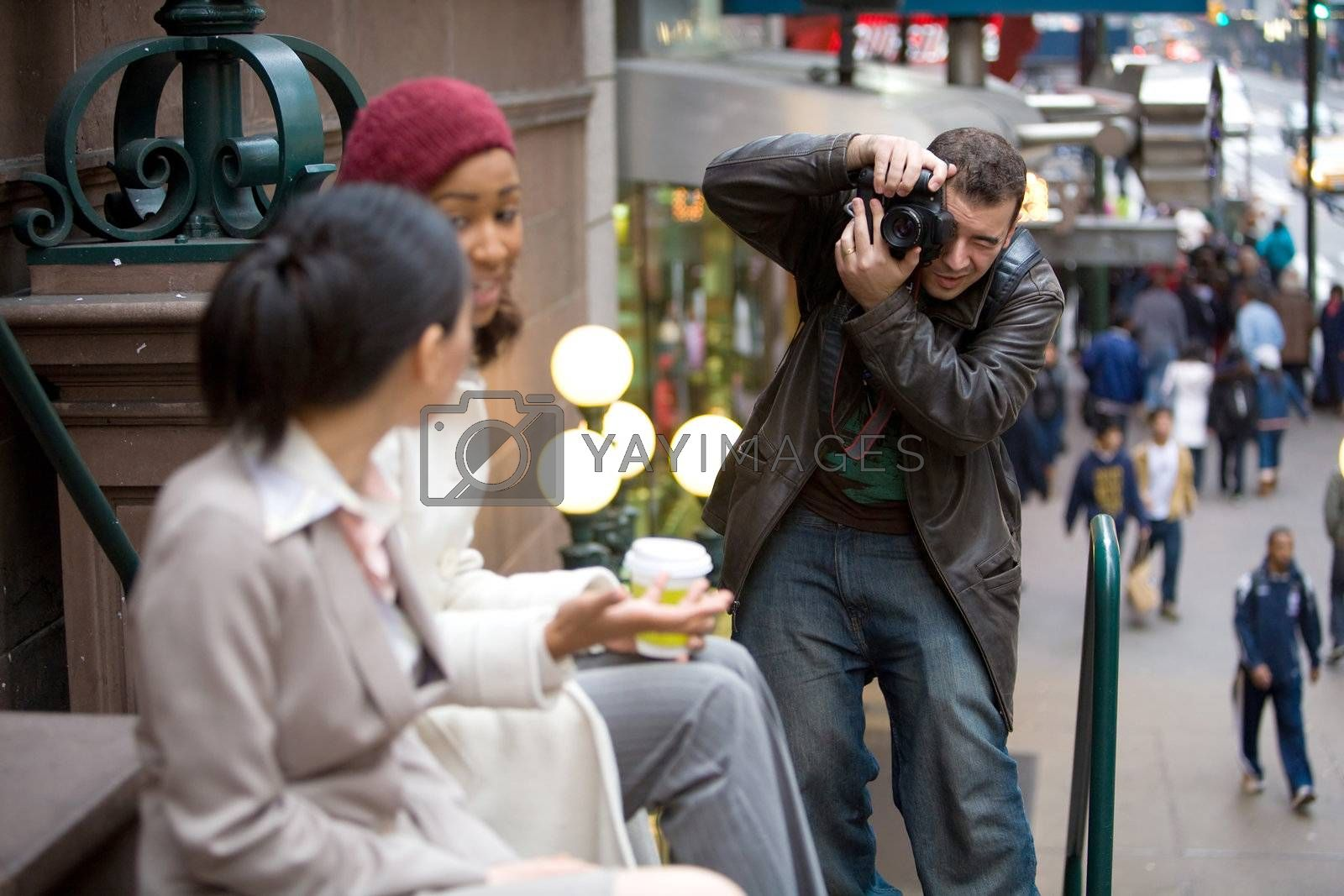 Commercial stock photographer during a photo shoot.  Shallow depth of field.
