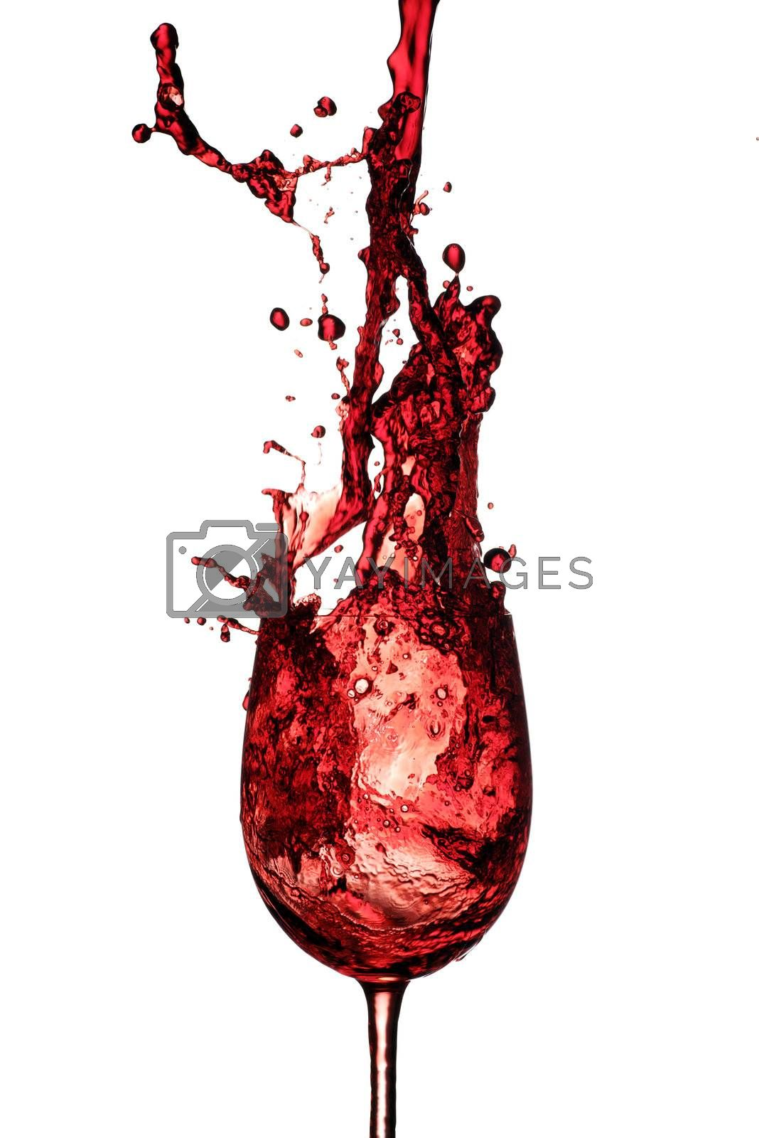 red wine being poured in to a wine glass from a height