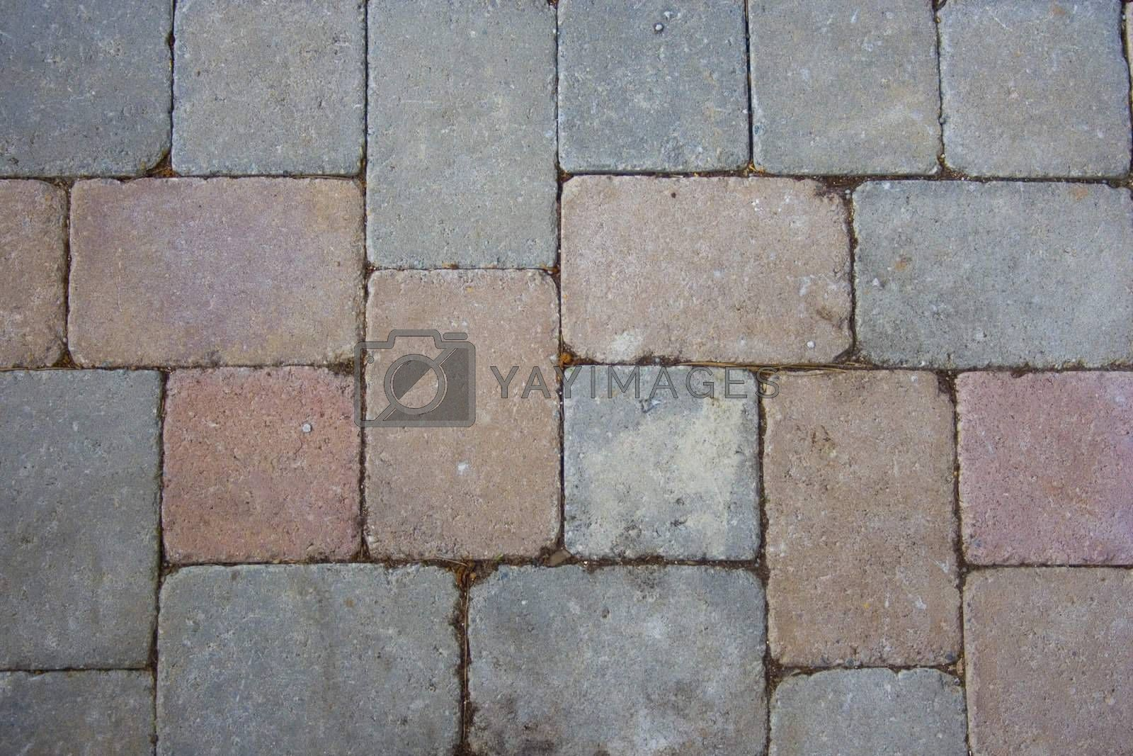 A pattern of bricks on the ground.