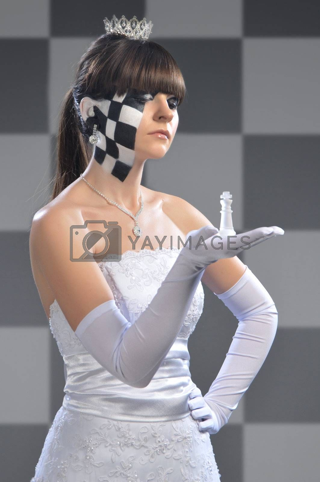 girl in the image of the chess queen keeps an open hand shape chess king