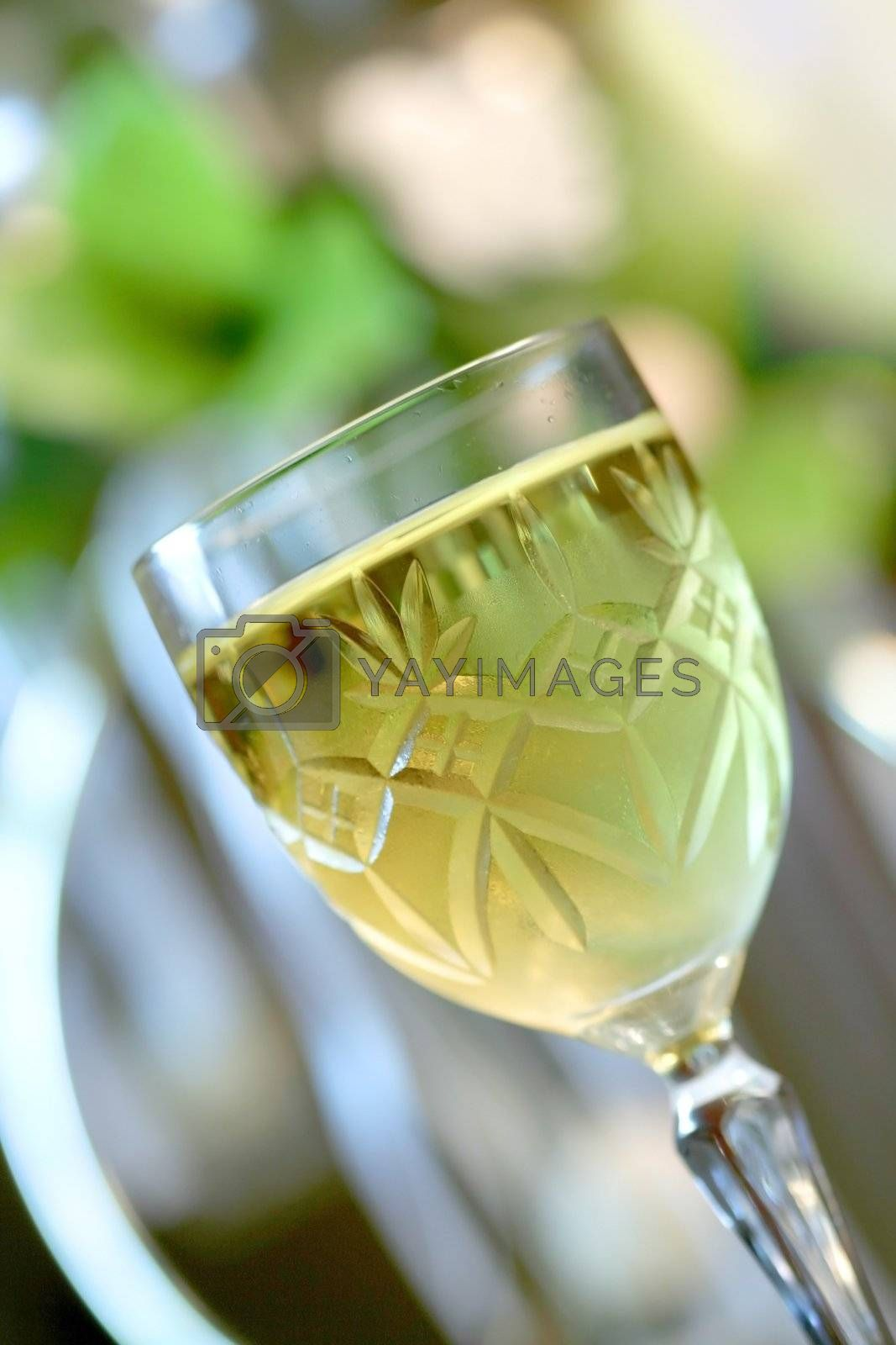 An image of a glass of white wine on a celebration party table