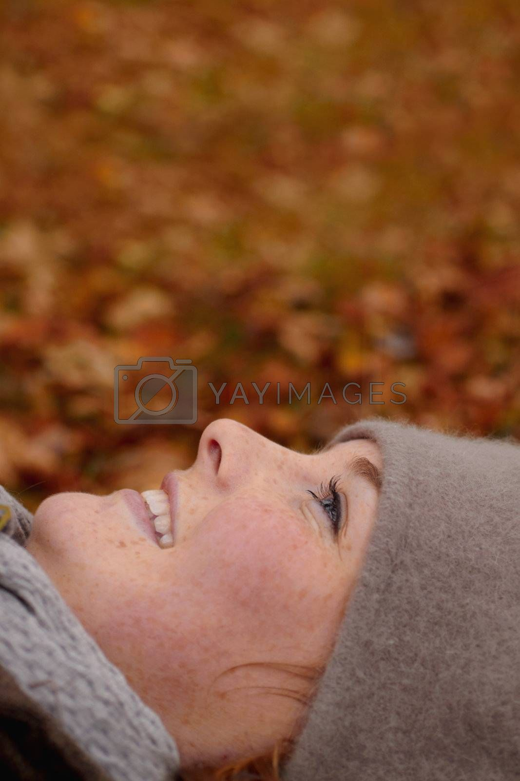 Royalty free image of Beautiful young woman looking up at copy space by FreedomImage