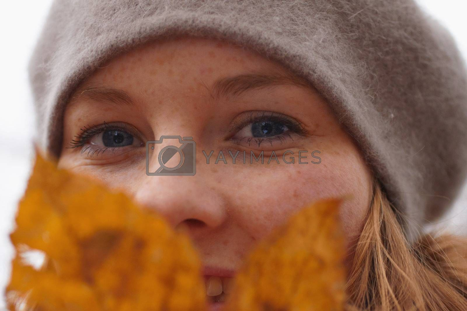 Royalty free image of Closeup of a cute young woman looking at you by FreedomImage