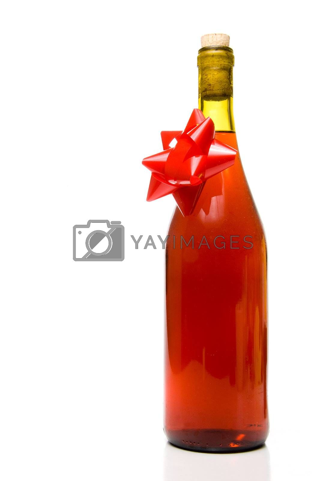 A bottle of wine with a Christmas bow