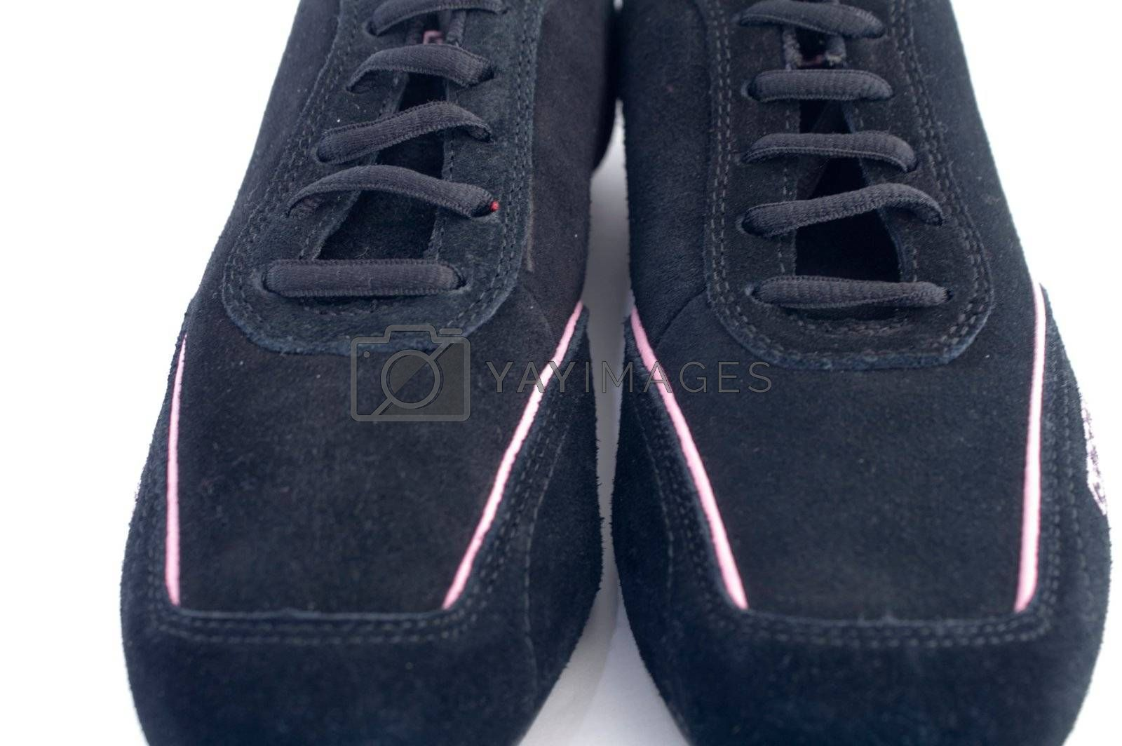 Black gym shoes on white background by olgaolga