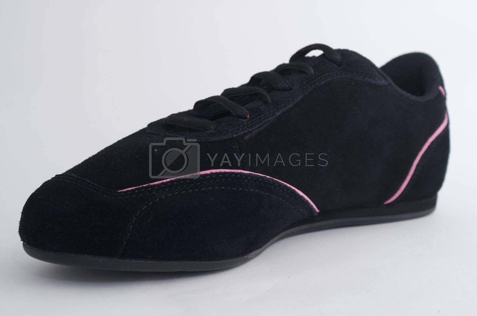Black gym shoes on white background by olgaolga