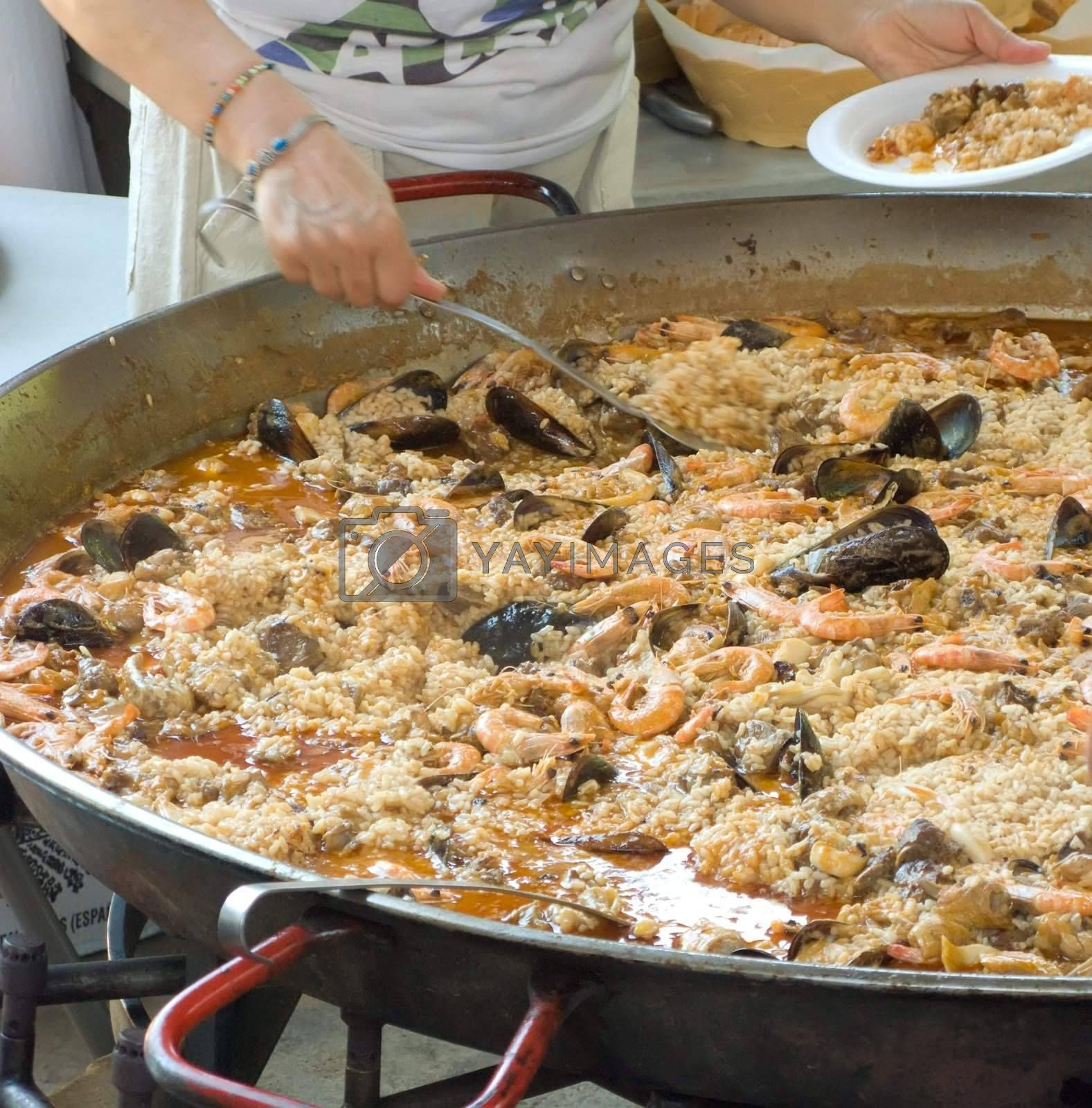 A one big paella for hundred person
