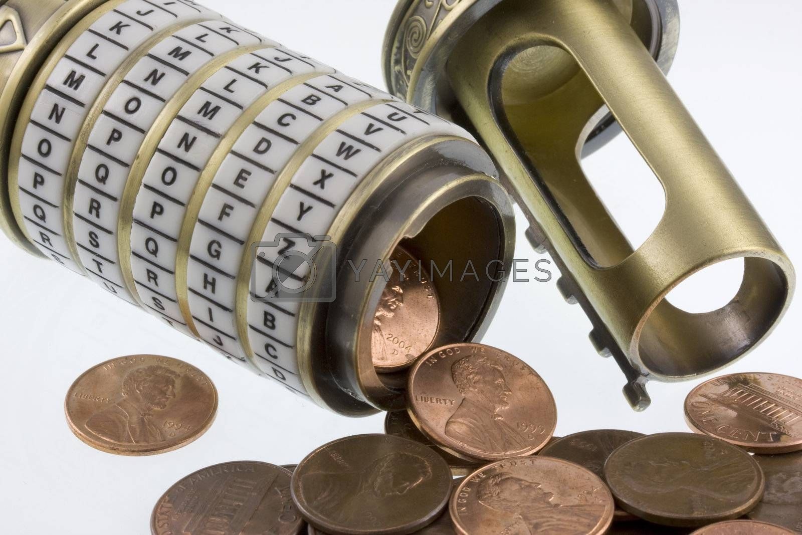money concept - coins (pennies)  spilling out from open conbination puzzle box with rings of letters (cryptex), see a set password