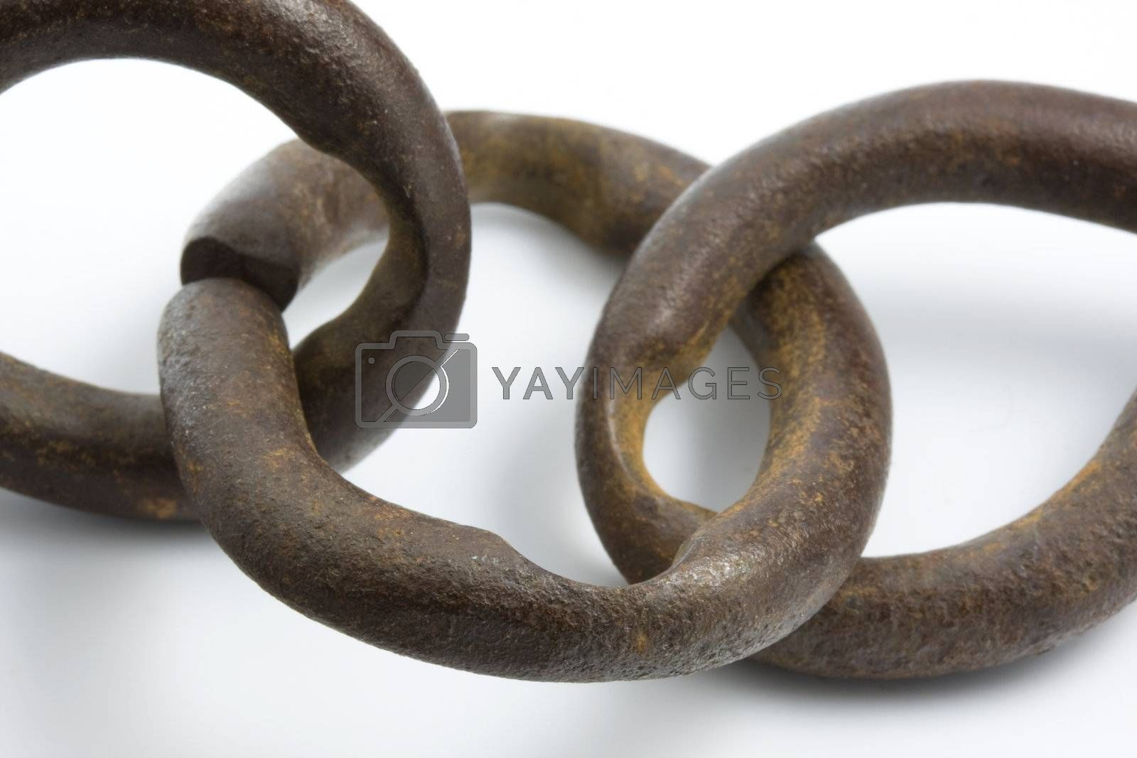 well worn and rusty chain links of some old farm machinery hardware