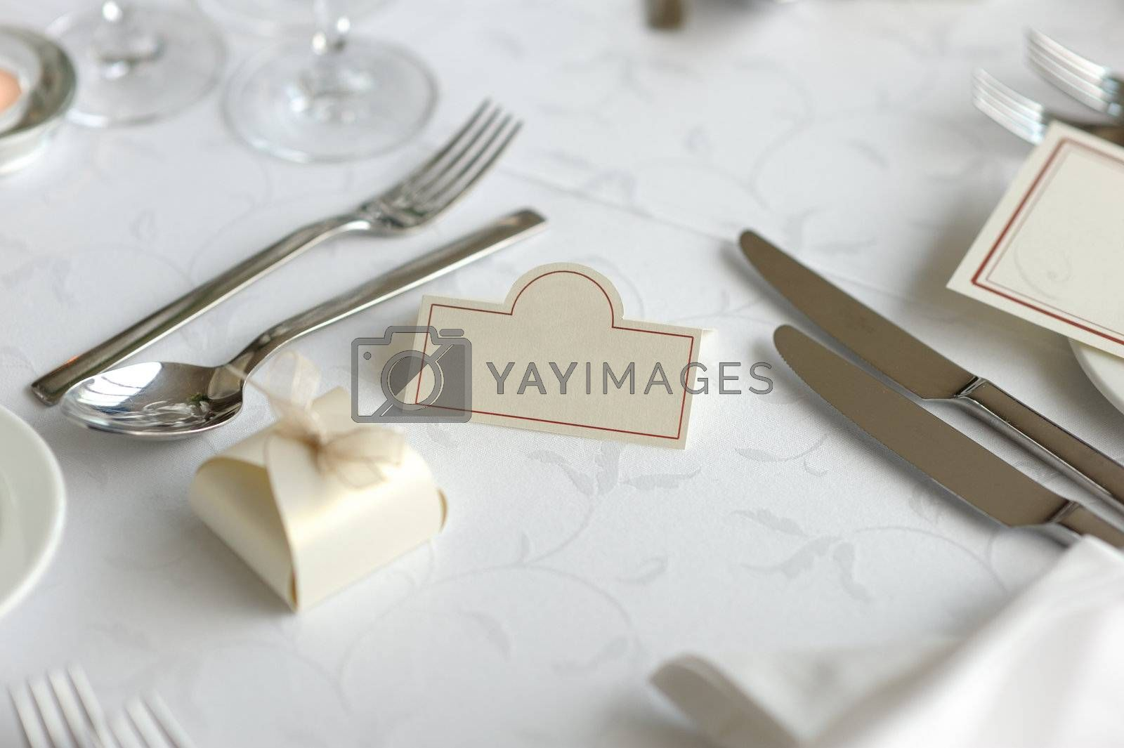 Empty place card on the nice festive table