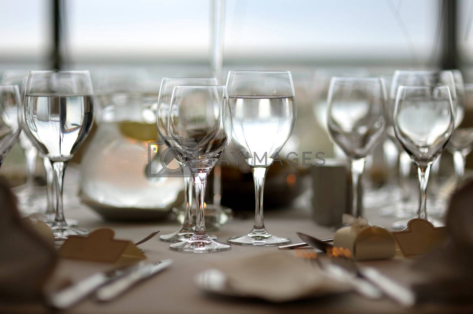Festive table setting with lots of wine glasses