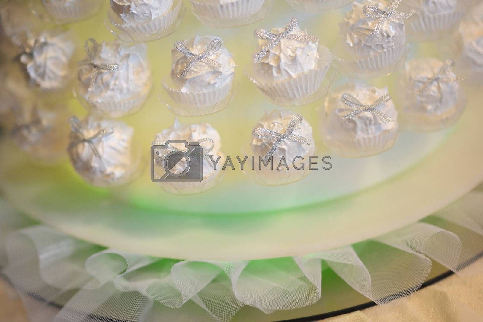 A bunch of wedding cupcakes on the nice green plate